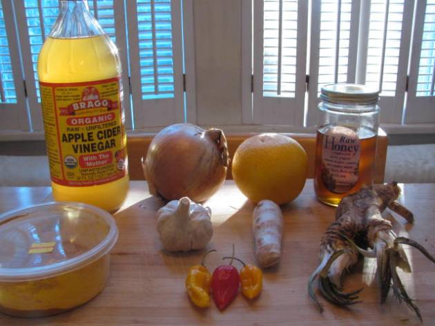 Apple Cider Vinegar, Honey, Horseradish and Ginger Roots, Garlic, Onion, Orange, Habanero Peppers and Ground Tumeric.