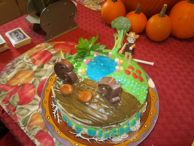 "Michael""s vegetable garden birthday cake, complete with a broccoli tree and an irrigation pond"