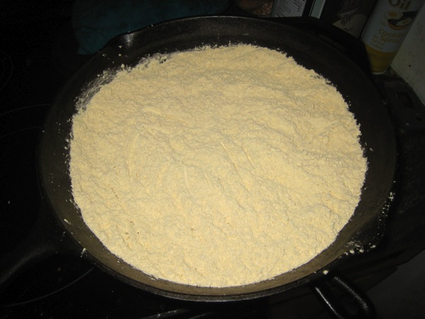 chickpea flour in cast iron pan