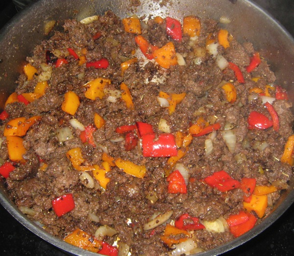 lightly-browned-onion-and-pepper-for-artless-joes.JPG