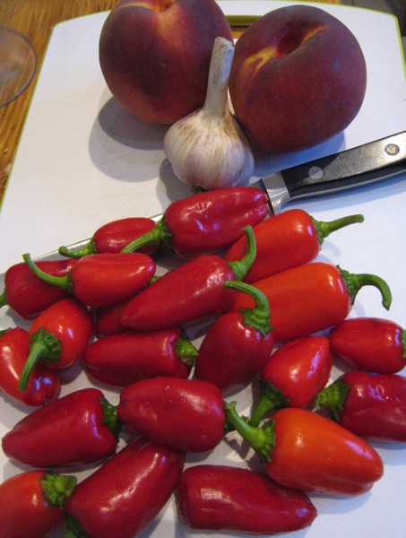 sweet and hot red peppers, peaches and garlic for hot sauce