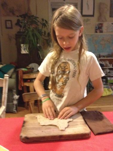 Felix shaping naan.