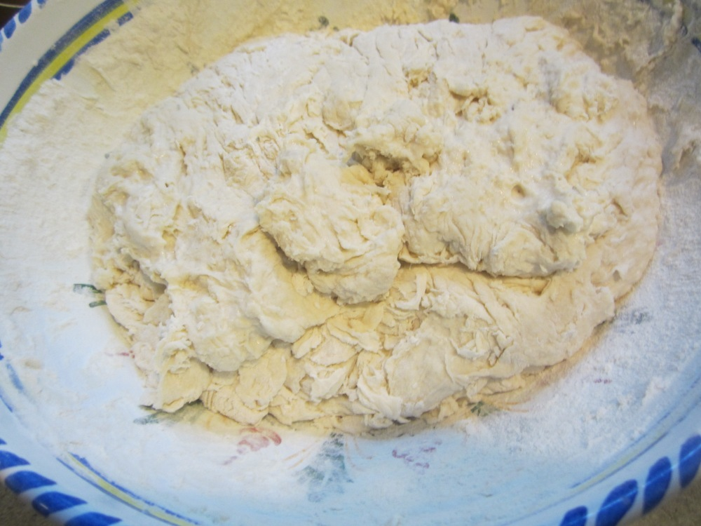 The dough is shaggy and sticky when you take it out of the bowl